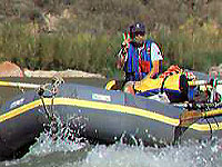 (c) Rob Kleine 1998.  Peace Man!  A Colorado River Rat flashes the peace sign while negotiating Tanner Rapids.  Grand Canyon National Park.